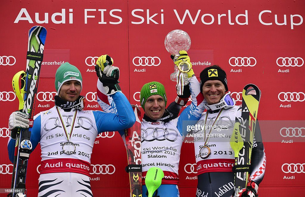 Austria's Marcel Hirscher (C) celebrates with his Crystal Globe trophy after winning the men's World cup Slalom, with Germany's Felix Neureuther (L) and Croatia's Ivica Kostelic, at the Alpine ski World Cup finals on March 17, 2013 in Lenzerheide.