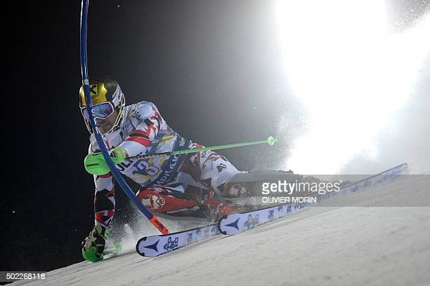Austria's Marcel Hirscher clears a gate during the first run of the Men's Slalom event of the FIS Ski World Cup in Madonna di Campiglio on December...