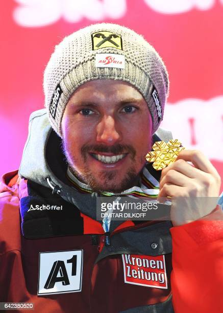 Austria's Marcel Hirscher poses with his gold medal on the podium after the men's giant slalom race at the 2017 FIS Alpine World Ski Championships in...
