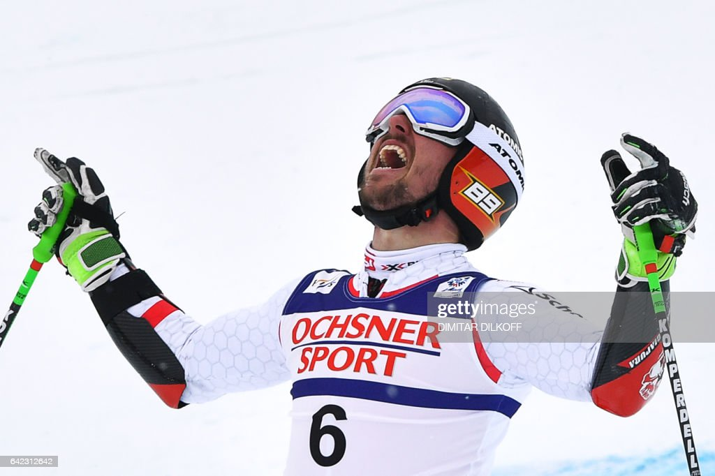 Austria's Marcel Hirscher reacts in the finish area after the second run of the men's giant slalom race at the 2017 FIS Alpine World Ski Championships in St Moritz on February 17, 2017. / AFP / Dimitar DILKOFF