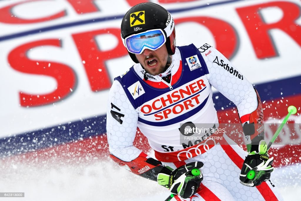 Austria's Marcel Hirscher reacts in the finish area after the second run of the men's giant slalom race at the 2017 FIS Alpine World Ski Championships in St Moritz on February 17, 2017. / AFP / Fabrice COFFRINI