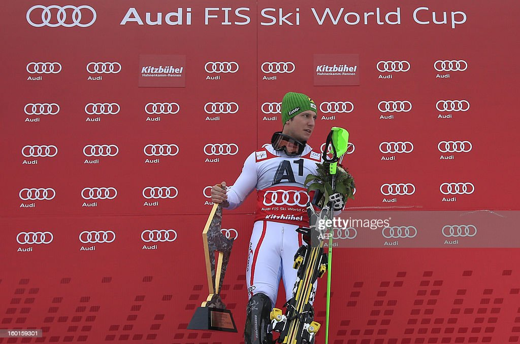 Austria's Marcel Hirscher stands on the podium and holds his trophy as he won the FIS World Cup men's slalom race on January 27, 2013 in Kitzbuehel, Austrian Alps. German Felix Neureuther placed second and Croatian Ivica Kostelic placed third.