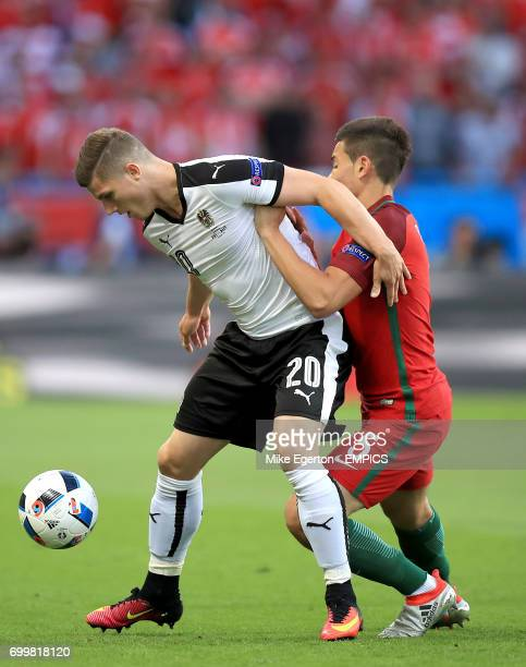 Austria's Marcel Sabitzer and Portugal's Raphael Guerreiro battle for the ball