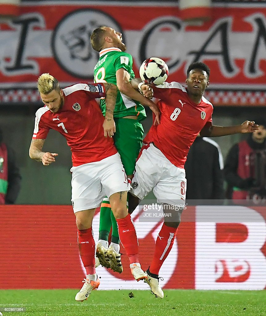 Austria's Marko Arnautovic (L) and David Alaba (R) vie with Ireland's David Meyler during the World Cup 2018 qualification football match between Austria and Ireland in Vienna on November 12, 2016. / AFP / JOE