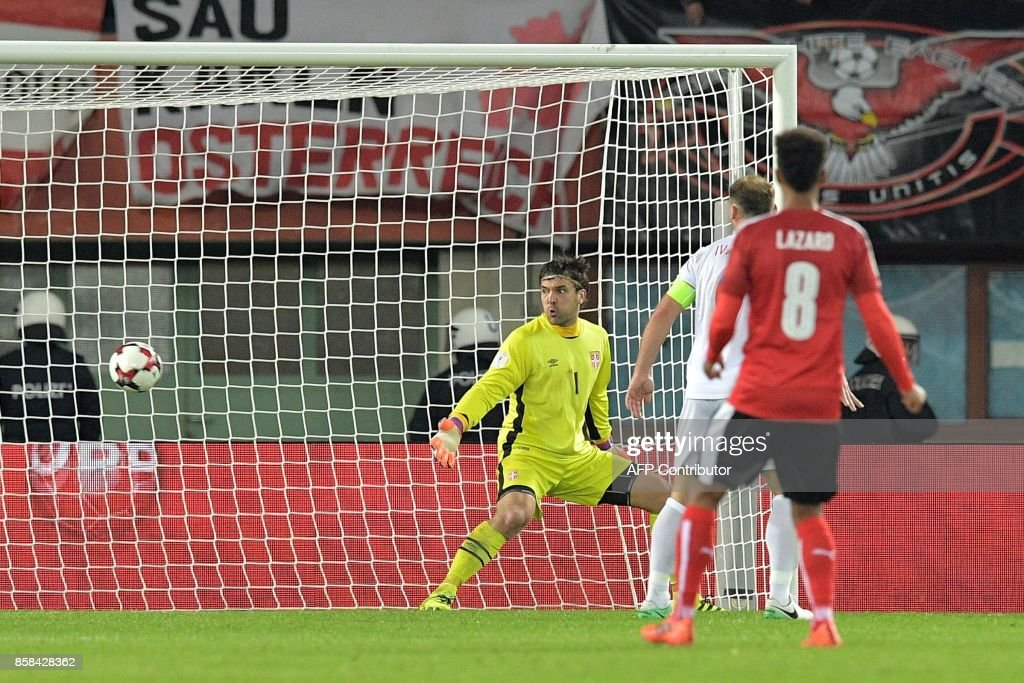 Austria's Marko Arnautovic (R) scores the third goal despite of Serbia's goalkeeper Vladimir Stojkovic (L) during the FIFA World Cup 2018 qualification football match between Austria and Serbia at the Ernst Happel stadium in Vienna on October 6, 2017. /