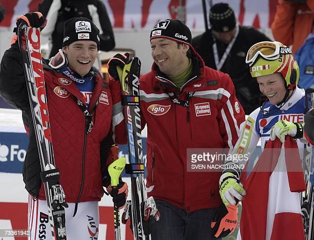 Austria's Marlies Schild Benjamin Raich and Fritz Strobl celebrate after winning the nations team event 18 February 2007 at the Alpine World Ski...