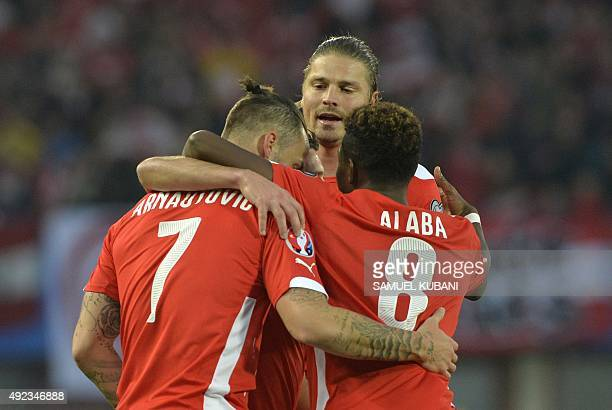 Austria's Maro Arnaiutovic David Alaba and Sebastian Proedl celebrate after scoring during the Euro 2016 Group G qualifying football match between...
