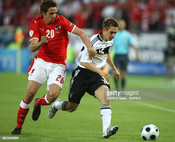 Austria's Martin Harnik and Germany's Philip Lahm battle for the ball