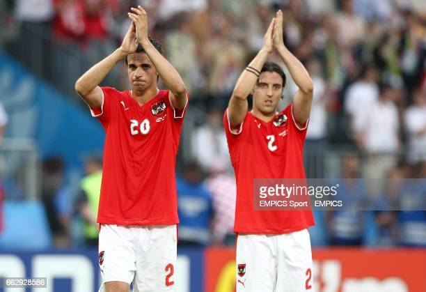 Austria's Martin Harnik and Joachim Standfest applaud the fans after the final whistle