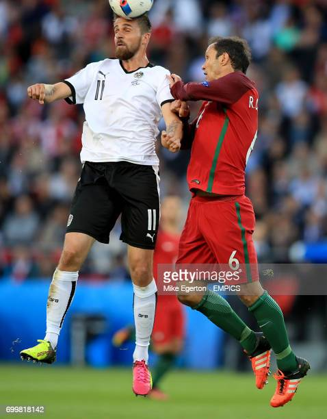 Austria's Martin Harnik and Portugal's Ricardo Carvalho battle for the ball in the air