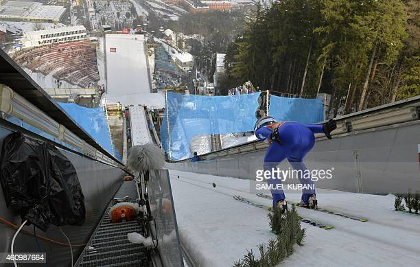 Austria's Michael Hayboeck practices during a training session of the Four Hills competition of the FIS Ski Jumping World Cup in Innsbruck on January...