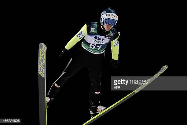 Austria's Michael Hayboeck soars during the World Cup Ski Jump event in the Holmenkollen Ski Arena in Oslo Saturday March 14 2015 AFP PHOTO / NTB...