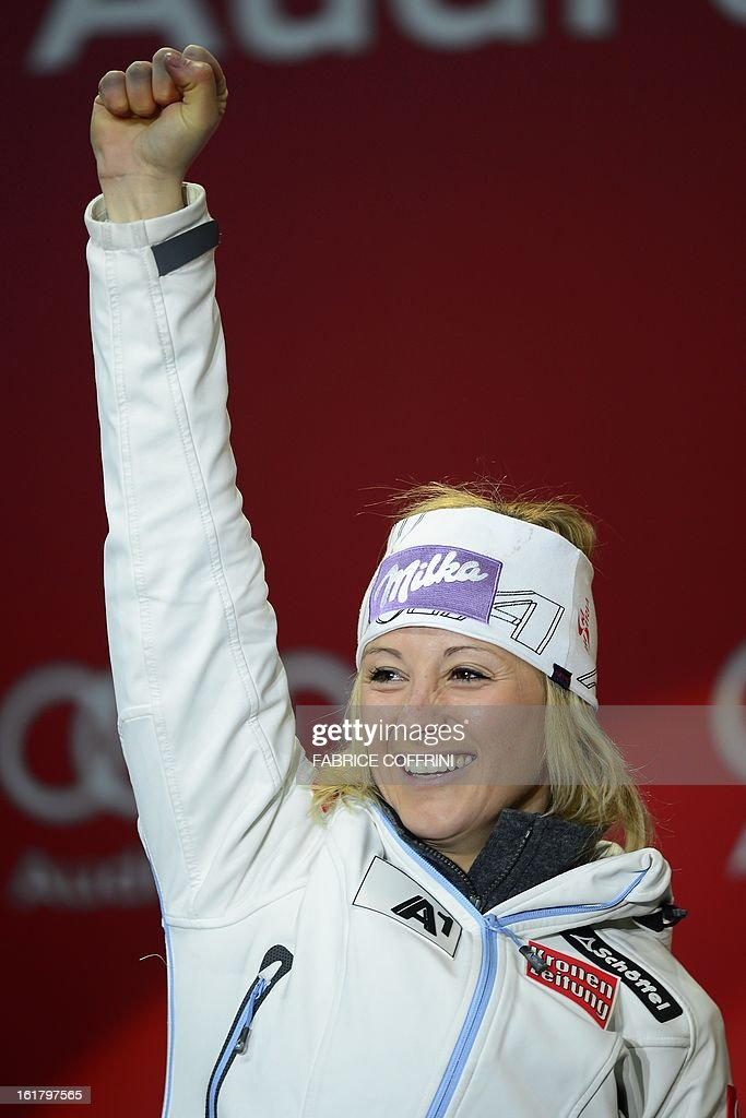 Austria's Michaela Kirchgasser waves during the medal awards ceremony after the women's slalom at the 2013 Ski World Championships in Schladming, Austria on February 16, 2013.