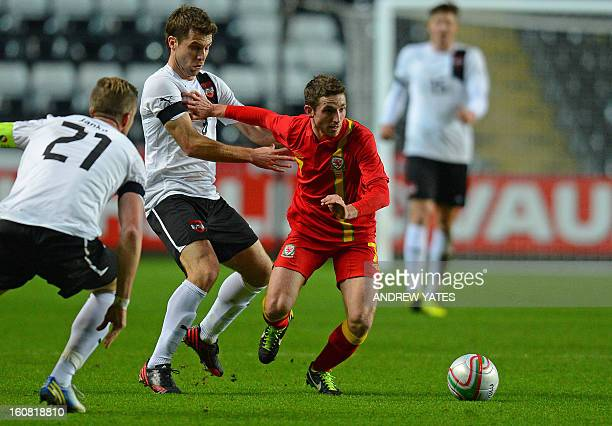 Austria's midfielder Andreas Ivanschitz vies with Wales' midfielder Joe Allen during the international friendly football match between Wales and...