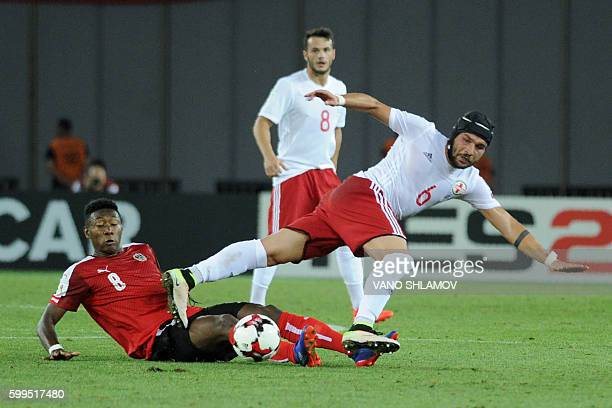 Austria's midfielder David Alaba and Georgia's midfielder Murtaz Daushvili vie for the ball during the World Cup 2018 football qualification match...