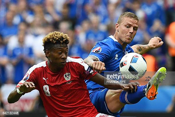 TOPSHOT Austria's midfielder David Alaba vies with Iceland's defender Ragnar Sigurdsson during the Euro 2016 group F football match between Iceland...