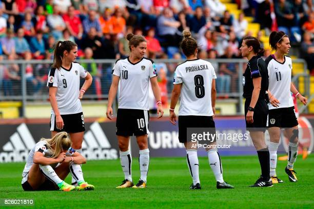 Austria's midfielder Sarah Puntigam reacts after a collision during the UEFA Womens Euro 2017 football tournament semifinal match between Denmark and...