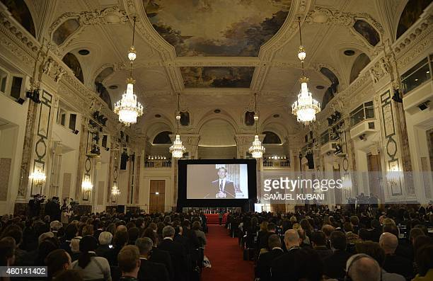 Austria's Minister for Foreign Affairs and Integration Sebastian Kurz is displayed on a screen as he speaks at the International conference on the...