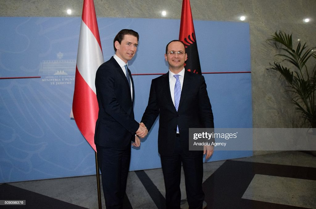 Austria's Minister for Foreign Affairs and Integration, Sebastian Kurz shakes hands with Albanian Foreign Minister Ditmir Bushati (R) during his official visit in Tirana, Albania on February 10, 2016.
