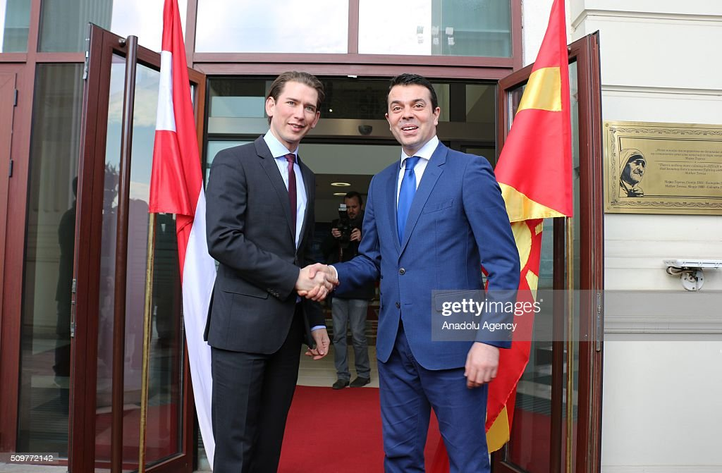 Austria's Minister for Foreign Affairs and Integration Sebastian Kurz (L) shakes hands with Macedonian Foreign Minister Nikola Poposki (R) before their meeting in Skopje, Macedonia on February 12, 2016.