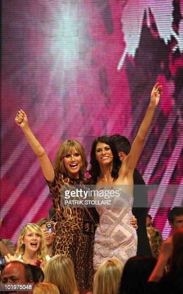 Austria's model Alisar Ailabouni winner of the TVshow 'Germany's Next Top Model' celebrates with the show's host German supermodel Heidi Klum after...