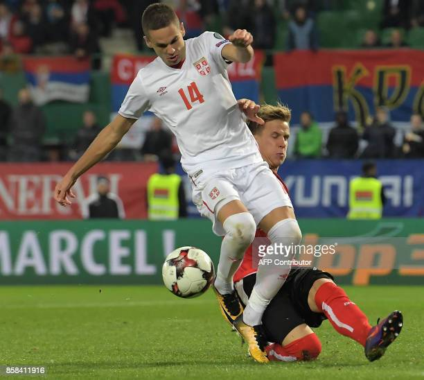 Austria's Moritz Bauer vies with Serbia's Mijat Gacinovic during the FIFA World Cup 2018 qualification football match between Austria and Serbia at...