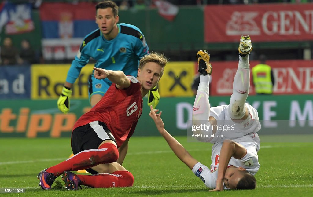 Austria's Moritz Bauer (L) vies with Serbia's Mijat Gacinovic (R) during the FIFA World Cup 2018 qualification football match between Austria and Serbia at the Ernst Happel stadium in Vienna on October 6, 2017. /