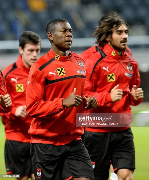 Austria's national football team players David Alaba and Veli Kavlak attend a training session on October 10 2013 on the eve of the FIFA 2014 World...