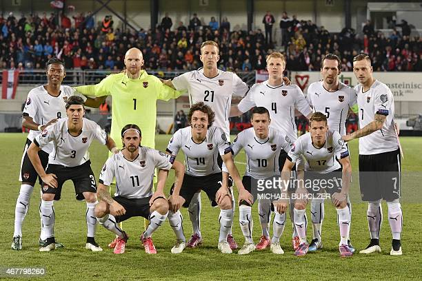 Austria's national football team players pose for a group photo before the Euro 2016 qualifying football match between Liechtenstein and Austria at...