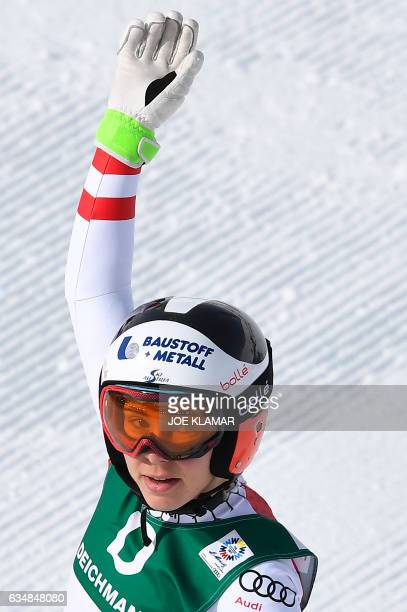 Austria's Nicole Schmidhofer reacts in the finish area of the women's downhill race at the 2017 FIS Alpine World Ski Championships in St Moritz on...