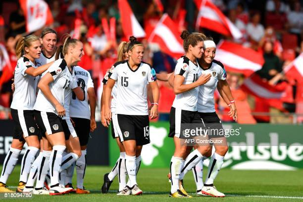 Austria's Nina Burger celabrates with teammates after scoring a goal during the UEFA Womens Euro 2017 football tournament match between Austria and...