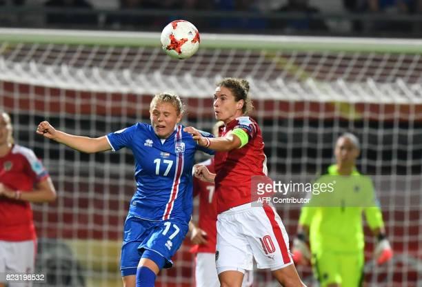 Austria's Nina Burger heads the ball with Iceland's Agla Maria Albertsdottir during the UEFA Women's Euro 2017 football match between Iceland and...