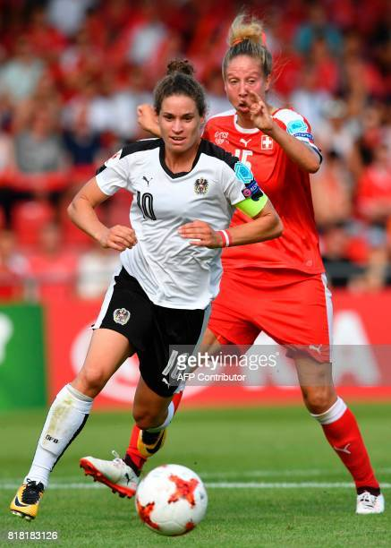 Austria's Nina Burger vies with Switzerland's Caroline Abbe during the UEFA Womens Euro 2017 football tournament match between Austria and...