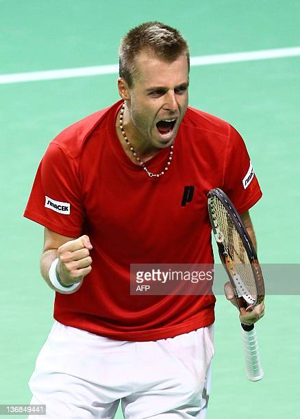 Austria's Oliver Marach reacts during the Davis Cup double game tennis match opposing Olivier Rochus and Steve Darcis of Belgium to Oliver Marach and...