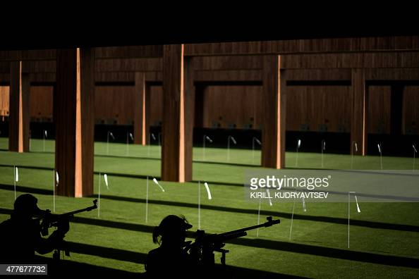 Austria's Olivia Hofmann and Switzerland's Petra Lustenberger compete in the women's 50m rifle 3 position event at the 2015 European Games in Baku on...