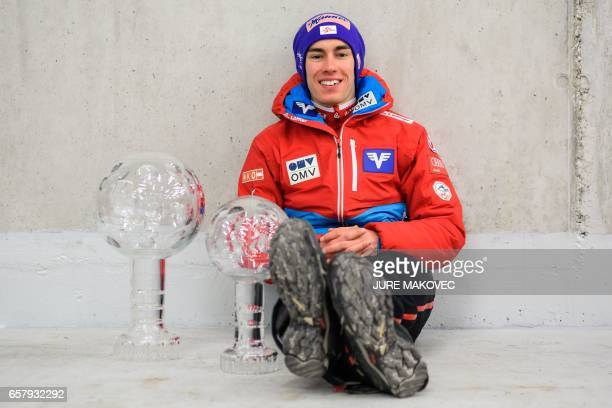 TOPSHOT Austria's Overall FIS Ski Jumping World Cup winner Stefan Kraft poses with his crystal globe trophies after winning the Ski Flying and Ski...