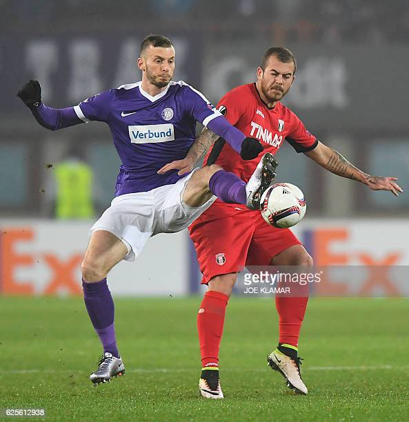 FK Austria's Petar Filipovic vies for the ball with FC Astra's Denis Alibec during the UEFA Europa League group E football match between Austria...