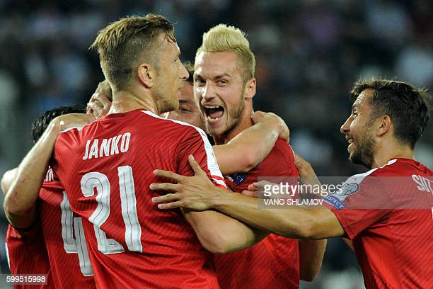 Austria's players celebrate a goal during the World Cup 2018 football qualification match between Georgia and Austria in Tbilisi on September 5 2016...