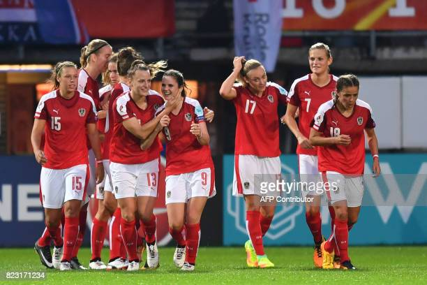 Austria's players celebrate after scoring a goal during the UEFA Women's Euro 2017 football match between Iceland and Austria at the Sparta Stadium...