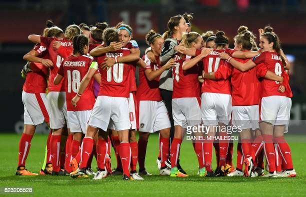 Austria's players celebrate at the end of the UEFA Women's Euro 2017 football match between Iceland and Austria at the Sparta Stadium in Rotterdam on...