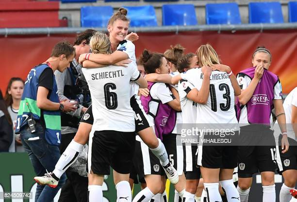 Austria's players celebrate winning the UEFA Womens Euro 2017 quarterfinal football match between Austria and Spain at the Willem II Stadium in...