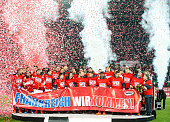 Austria's players celebrate with the banner reading 'France we are coming' after winning the UEFA EURO 2016 Qualifier between Austria and...