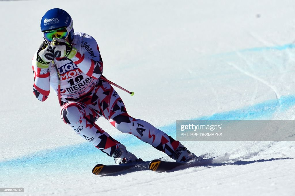 Austria's Romed Baumann competes in the Men's downhill at the FIS Alpine Skiing World Cup finals in Meribel on March 18 2015 AFP PHOTO / PHILIPPE...