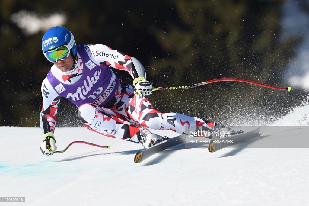 Austria's Romed Baumann competes in the Men's Super G race at the FIS Alpine Skiing World Cup finals in Meribel on March 19 2015 AFP PHOTO / PHILIPPE...