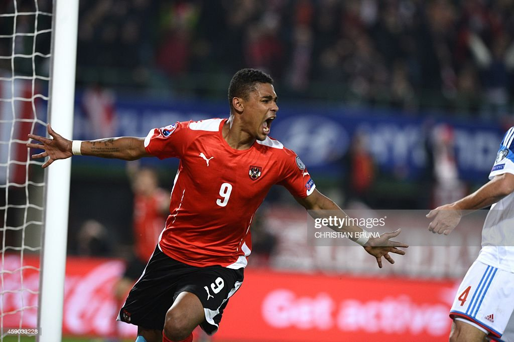 Austria's Rubin Okotie celebrates after scoring a goal during the UEFA 2016 European Championship qualifying round Group G football match Austria vs...