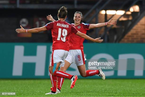 Austria's Sarah Zadrazil celebrates with teammate Verena Aschauer after scoring a goal during the UEFA Women's Euro 2017 football match between...