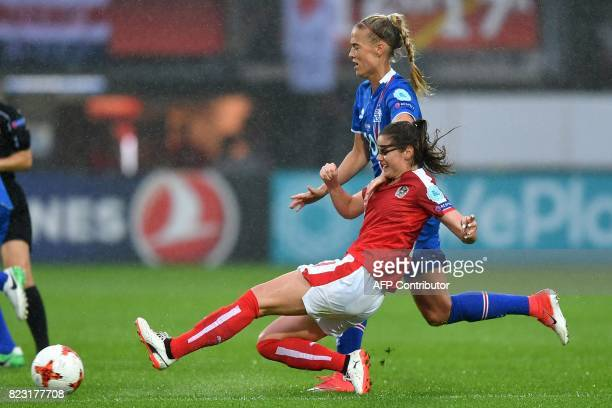 Austria's Sarah Zadrazil challenges Iceland's Dagny Brynjarsdottir during the UEFA Women's Euro 2017 football match between Iceland and Austria at...