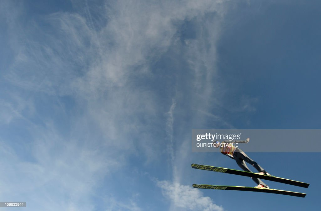 Austria's ski jumper Gregor Schlierenzauer soars through the air during the 61th edition of the Four-Hills-Tournament (Vierschanzentournee) on December 31, 2012 in Garmisch-Partenkirchen, southern Germany. The second competition of the jumping event will take place in Garmisch-Partenkirchen, before the tournament continues in Innsbruck (Austria) and in Bischofshofen (Austria).