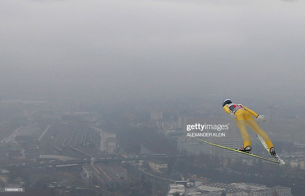 Austria's ski jumper Michael Hayboek soars through the air during a training session at the 61st Four Hills tournament in Innsbruck, Austria on January 4, 2013. Austria's Schlierenzauer won ahead of Poland's Kamil Stoch and Norway's Anders Bardal.