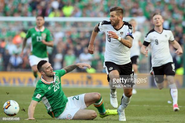 Austria's striker Guido Burgstaller vies with Republic of Ireland's defender Shane Duffy during the group D World Cup qualifying football match...